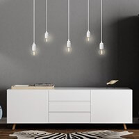 Bulb Attack Uno pendant lamp in white holders and white power cords
